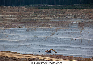 Glass sand quarry - Excavator mining layer of glass sand