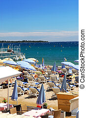 Beach in Cannes, France - Beach along Croisette promenade in...