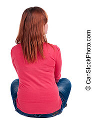 Back view of beautiful young woman in jeans sitting and...
