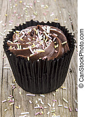 cup cake with chocolate buttercream and colored sprinkles