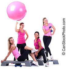 group of fitness instructors stand with accesories - young...