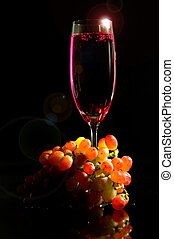 red wine and grape on a black background