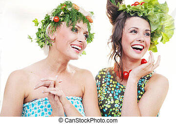 Adorable young women with vegetables hairstyles