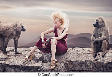 Blond beauty posing with monkeys