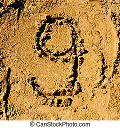 sand number - number 9 made from a sand