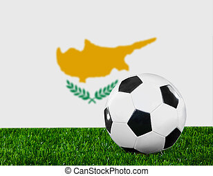 The Cypriot flag and soccer ball on the green grass.