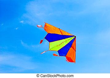 kite flying in the blue sky