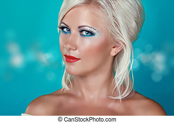Glamour portrait of beautiful woman model with makeup and blond hairstyle.