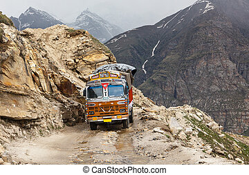 Manali-Leh road in Indian Himalayas with lorry. Himachal...