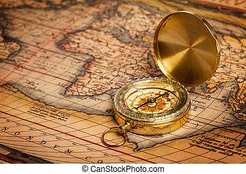 Old vintage golden compass on ancient map - Old vintage...