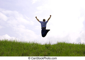 jump  - Young guy in jump on background field