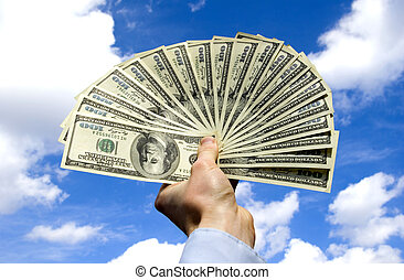 Money in hand  isolated on sky background