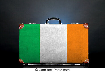 The irish flag on a suitcase for travel.