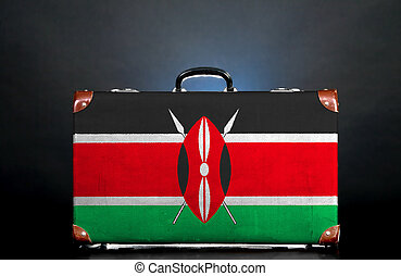 The Kenyan flag on a suitcase for travel.