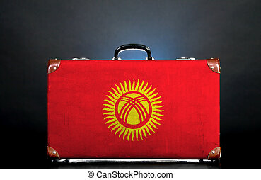 The Kyrgyz Flag on a suitcase for travel.