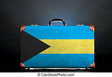 The Bahamas flag on a suitcase for travel.