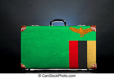 The Zambian flag on a suitcase for travel.