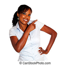 Stylish young woman looking at you pointing left