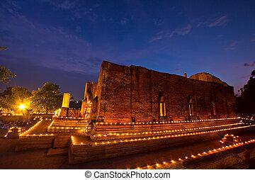 Makha Bucha candle lit.