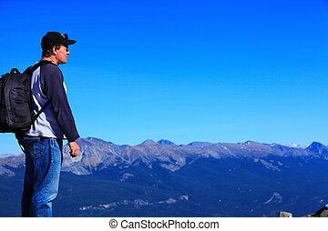 hiker on mountain range - hiker on top of mountain...