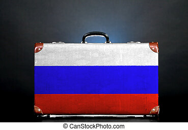 The Russian flag on a suitcase for travel.