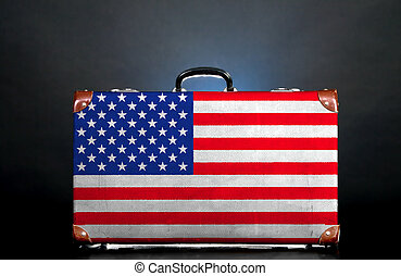 The USA flag on a suitcase for travel.