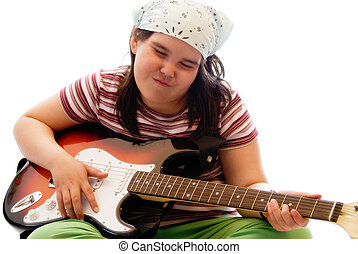 Child Rockstar - A young girl pretending to be a rockstar by...