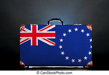 The Cook Islands flag on a suitcase for travel.