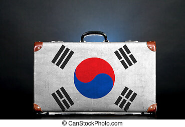 The South Korea flag on a suitcase for travel.