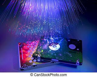 computer harddisk and heads on technology fiber optics background