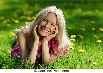 girl on dandelion field