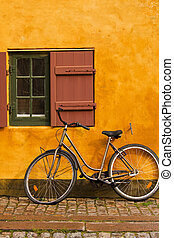 Bike and cottage - Bike parked in front of a rustic cottage