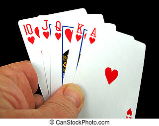 Royal flush Hearts - Person holding the royal flush in...
