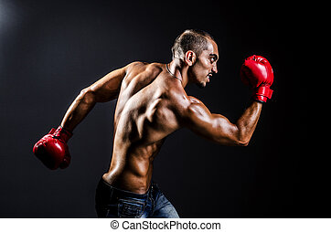 Young man with boxing gloves