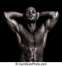 Nude muscular guy posing with hands behind head. Black and...