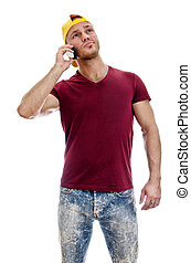 Cool handsome guy with mobile phone Isolated on white