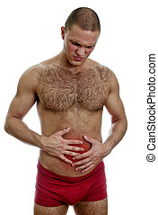 Front view of muscular man suffering from stomach pain....
