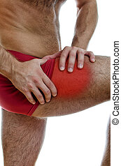 Close up view of male hands holding his leg with muscular...
