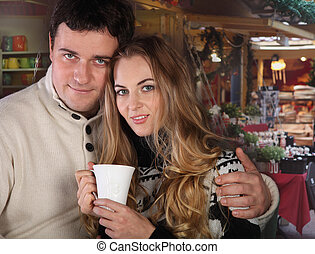 Portrait of a happy young couple on Christmas market