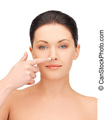 beautiful woman pointing to nose - picture of beautiful...