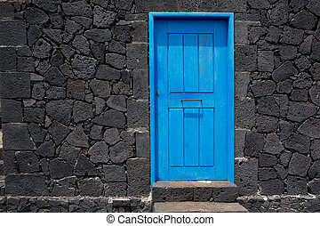 Blue door lava stone masonry wall at La Palma - Blue door in...