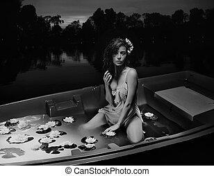 Beauty brunette in boat