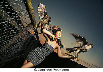 Elegance lady holding eagles
