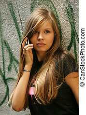 Girl - teenager - The young girl with phone on a background...
