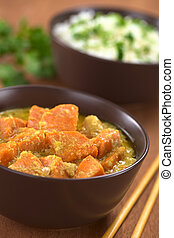 Sweet Potato and Coconut Curry - Bowl of vegetarian sweet...