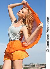 Blonde woman enjoying summer