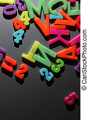 Colorful letters on gray metallic background
