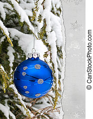 Holiday ornament on torn paper
