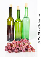 Grapes and red wine bottle - Grapes and three red bottle