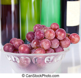 Grapes and red wine bottle - Grapes and three red bottle...